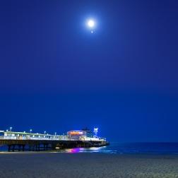 Moon and Jupiter above Bournemouth Pier Dorset UK